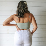 -Teal -Ribbed -Spaghetti Straps -Key Hole Cut Out -Cinched -Cropped -Fabric Stretches -Tank Top -Comes in 7 Colors  Material: 95% Polyester 5% Spandex  HF21E642 CROP TEAL