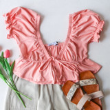 -Pink -Puff Sleeve with Ruffle -Sweetheart Neck Line -Peplum Bottom -Front Tie -Fabric Does Not Stretch -Crop -Comes in 4 Colors  Material: 95% Cotton 5% Spandex  HF21E806 CROP PNK