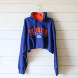 """-Blue and Orange -Reads """"Florida Tradition"""" -Hoodie  -Drawstring Attached -Cropped Length -Long Sleeve -Sweater  Size Extra Large  Material: 70% Cotton 30% Polyester  Clothing Measurements: Bust: 54"""" Length: 12"""" Sleeve Length: 23"""""""