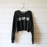 """-Black with Grey -Reads """"Champion"""" -Crew Neck -Cropped Length -Long Sleeve -Sweater  Size 2X Large  Material: Cotton and Polyester Blend  Clothing Measurements: Bust: 52"""" Length: 16"""" Sleeve Length: 25"""""""