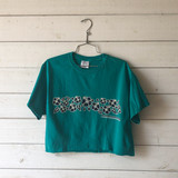 """-Teal with Black and White Writing -Reads """"Hawaii"""" -Crew Neck -Cropped Length -Short Sleeve -T-Shirt  Size Medium  Material: 100% Cotton  Clothing Measurements: Bust: 36"""" Length: 16"""" Sleeve Length: 7"""""""