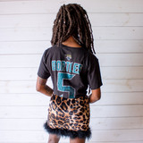 """-Black with Blue Print -Reads """"JACKSONVILLE"""" -Official NFL Team Apparel -Crew Neck -Cropped Length -Short Sleeve -T-Shirt  Size Medium  Material: 100% Cotton  Clothing Measurements: Bust: 38"""" Length: 12"""" Sleeve Length: 9"""""""