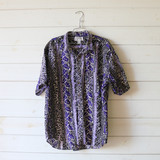 """-Black and Purple Leaf Print -Collard Shirt -Button Up -Short Sleeve  Size Extra Large  Material: 100% Cotton  Clothing Measurements: Bust: 40"""" Length: 26"""" Sleeve Length: 10"""""""