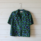 """-Black, Blue, and Green Floral Print -Collared Shirt -Button Up -Short Sleeve  Size Extra Large  Material: 100% Polyester  Clothing Measurements: Bust: 40"""" Length: 19"""" Sleeve Length: 10"""""""