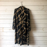 """-Black and Gold Chains Print -Collared Neckline -Button Up -2 Pockets -Long Sleeve  Size Large  Material: 100% Cotton  Clothing Measurements: Bust: 35"""" Length: 40"""" Sleeve Length: 23"""""""