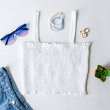 -White Color -Small Ruffle Top and Bottom -Thick Straps -Smocked -Knit -Tank -Cinched -Comes in 4 Colors  Model is wearing Size Small  Material: 95% Cotton 5% Spandex  DZ21E203 TANK WHT