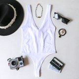 -White Color -Thick Straps -V-Neck -Open Back -Ribbed -Fabric Stretches -Thong -Hook and Eye Clasp -One Size Fits Most -Bodysuit  Material: 92% Nylon | 8% Spandex  762 BSUIT WHT ONE SIZE