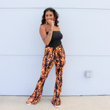 -Black and Red Color -Flame Print -Elastic Waistband  -Flare  -Fabric Does Stretch  Material Content: 95% Polyester | 5% Spandex   P2310 PANT FIRE