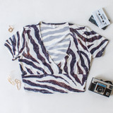 -White and Black Zebra Print -T-Shirt Sleeves -V-Neck  -Wraps in Front -Fabric Stretches -Crop Top  Material: 95% Polyester | 5% Spandex  T8671 TOP ZEB