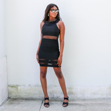 -Black Color -Can Be Worn Off the Shoulder or as Cowl Neck -Mesh Cutout at Waist -Mesh Cutouts at Bottoms -Fabric Stretches -Mini Dress Length -Dress  Materials: 96% Polyester   4% Spandex  HMD12648 DRESS BLK