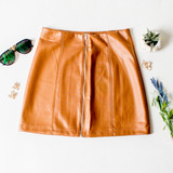 -Cognac (Brown) Color -Zipper Up Front -Elastic Waistband -Vertical Stitching -Fabric Does Not Stretch -Pleather Material -Skirt  Materials: Polyester 94%, Spandex 6%  92691 SKIRT BRN