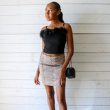 -Leopard Print -Faux Suede -Slit at Hemline -Zipper in Back -Lined -Skirt  Materials: Cotton 55%   Polyester 42%   Spandex 3%  92992 SKIRT CHTA