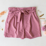 -Mauve Color -Bow -Ties -Belt Loops -Pockets -Elastic Waist -High Waist -Paper Bag Style -Fabric Stretches -Shorts  Material: Linen 50%   Rayon 50%  94625 SHORT PRP