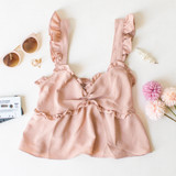-Tan Color -Elastic Straps w/ Ruffles -Cinched in Middle -Peplum Flare -Smocked Back -Ruffle Neckline -Comes in 5 Colors -Crop Top Length -Tank Top  Materials: 100% Polyester  TM32628 CROP TAN
