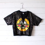 """-Black Color -Guns & Roses Print -White Acid Wash -Distressed on Front -Size Medium and Large Available -Lace Up Front -Open V Neck -Oversized Fit -Raw Bottom -Tee Shirt  Materials: 100% Cotton  Clothing Measurements: Bust: 21"""" Length: 24"""" Sleeve Length: 9"""""""