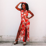 -Red Color -Tropical Print -Halter Neckline -Open Back -Ties in Back -Keyhole Cut Down Center -Slits on Side of Legs -One Piece -Jumpsuit  Model is Wearing Size Small  Materials: 94% Polyester | 6% Spandex  P1383 JUMPS ORG