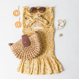 -Yellow Color -Floral Print -High Waisted -Smocked Elastic Fit -Bottom Ruffle -Matching Set (Bottoms) -Skirt  Materials: 95% Polyester   5% Spandex  WS8042 SKIRT YELF
