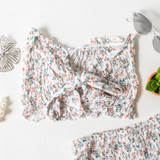-White Color -Floral Print -Smocked Elastic Material -Ties in Front -Ruffle on Top and Bottom -Matching Set (Top) -Bandeau/Crop Top  Materials: 100% Rayon  WN8479 CROP WHTF