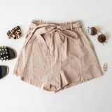 -Tan Color -Ties in Front -Soft Terry Cloth-Like Material -Pleated -Elastic Waistband -Pockets -Lined -Short  Materials: 100% Cotton  HF21G011 SHORT TAN