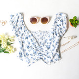 -White Color -Blue Floral Pattern -Smocked Elastic Back -Ruched in Front -Front Rushing is Adjustable -Short Puff Sleeves (Elastic) -Sweetheart Neckline -Crop Top  Materials: 100% Rayon  WN8536 CROP BLUF