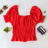 -Red Color -Elastic Puff Sleeve -Ruffle at Top and Bottom -Elastic Neckline -Ruching Down Center -Can be Worn On and Off Shoulder -Fabric Stretches -Top  Materials: 62% Rayon   38% Polyester  WN8202 CROP RED