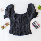-Black Color -Elastic Puff Sleeve -Ruffle at Top and Bottom -Elastic Neckline -Ruching Down Center -Can be Worn On and Off Shoulder -Fabric Stretches -Top  Materials: 62% Rayon | 38% Polyester  WN8202 CROP BLK