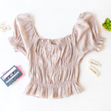 -Tan Color -Elastic Puff Sleeve -Ruffle at Top and Bottom -Elastic Neckline -Ruching Down Center -Can be Worn On and Off Shoulder -Fabric Stretches -Top  Materials: 62% Rayon | 38% Polyester  WN8202 CROP TAN