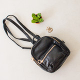 -Black Color -Gold Accents -Snakeskin Texture -Pleather Material  -Zipper Pocket on Front -Zipper Pocket Inside -Lined -Adjustable Straps -Straps Can Be Adjusted to Wear as Backpack or Crossbody Purse -Handle on Top -Crossbody Bag -Backpack  0321 CCBSG 20