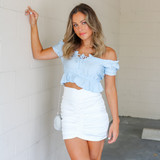-Baby Blue Color -Ruffle Neckline -Ties in Front -Short Sleeve -Peplum Hem -Can Be Worn On/Off Shoulder -Top  Materials: 80% Rayon | 20% Nylon  HF21E640 TOP BLU
