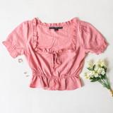 -Pink Color -Ruffle Neckline -Ties in Front -Short Sleeve -Peplum Hem -Top  Materials: 80% Rayon   20% Nylon  HF21E640 TOP PNK