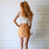 -Orange Color -Ruched on Front -Zipper Closure in Back -V-Cut Detail in Front -Lined with Shorts -Mini Skirt  Materials: 80% Polyester | 20% Cotton  CS5291 SKIRT ORG