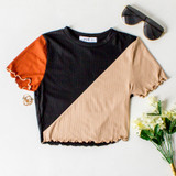 -Rust, Black, and Tan Colors -Short Sleeve -Crew Neck -Ruffle Edge Bottom -Crop Top -Crop Tee  Materials: 91% Polyester | 9% Spandex  A825 TEE BLK