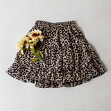 -White and Tan Color -Leopard Print -Elastic Waistband -Tiered Style  -Lined with Shorts -Skort  Materials: 100% Polyester  CS5075 SKIRT WHTP
