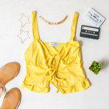 -Yellow Color -Ribbed -Open Front -Double Tie -Tank Straps -Tank Top -Ruffle Hem  Materials: 91% Polyester   9% Spandex  TB9273 TANK YEL