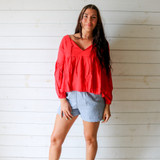 -Red Color -V-Neck -Ties in Front -Puff Sleeves -Long, Relaxed Fit -Flares at Waist -Long Sleeves -Top  Materials: 95% Polyester   5% Spandex  31195TI TOP RED