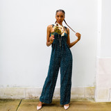 -Dark Green and White Color -Polka Dot Pattern -Skinny Tie Straps -Smocked Bodice -Square Neckline -Relaxed Pant Legs -Jumpsuit  Materials: 100% Polyester  36339RC JUMP GRN