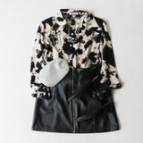 -Black and White Colors -Bleached Pattern -Button Up Shirt -Light Chiffon Material -Long Sleeves -Collared -Button Cuffs on Sleeves -Blouse -Top  Materials: 100% Polyester  49520THYS TOP BLCH