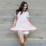 -Pink Color -V-Neck -Short Sleeves -Flares at Waist -Babydoll Fit -Top  Materials: 95% Polyester   5% Spandex  50076TYO TEE PNK
