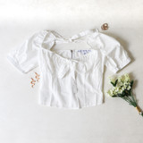 -White Color -Puff Sleve -Elastic Neckline -Ties in Front and Back -Zipper Closure -Crop Top -Top  Materials: 55% Cotton 45% Polyester   HF21G029 TOP WHT