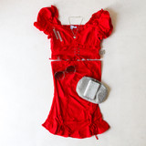 -Red Color -High Waisted -Drawstring Ties on Front -Elastic Back -Ruffle on Bottom -Two Piece Set -Skirt  Materials: 72% Rayon   24% Nylon   4% Spandex  SSET7059 SKIRT RED