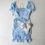 -Baby Blue Color -V-Neckline -Ruffle Neckline and Sleeves -Elastic Puff Sleeves -Corset Detail on Front -Smocked Back -Two Piece Set -Crop Top  Materials: 72% Rayon | 24% Nylon | 4% Spandex  SSET7059 CROP BLU