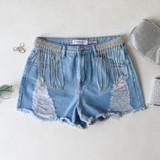 -Light Denim Wash -Distressed -Frayed -Pockets on Front and Back -Belt Loops -Rhinestone Belt Detail -Shorts  Materials: 100% Cotton  DBS0448 SHORT LTD