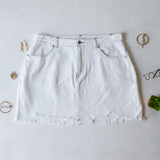-White Wash Denim -Front and Back Pockets -Raw Hem -Button and Zipper Closure -Comes in 3 Colors -Skirt  Materials: 100% Cotton  HF21G100 SKIRT WHT