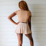 -Tan, Yellow, and White Colors -Plaid Print -Pleated  -Zipper Closure -Skort (Shorts Lining)  Materials: 80% Polyester   15% Cotton   5% Spandex  HF22A591 SKIRT TAN