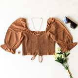-Tan Color -Ruffle Neckline -Ruched Bodice -Bubble Short Sleeves -Can Be Worn On/Off Shoulder -Drawstring Bottom -Crop Top  Materials: 100% Polyester   TGI3487 CROP TAN