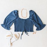 -Powder Blue Color -Ruffle Neckline -Ruched Bodice -Bubble Short Sleeves -Can Be Worn On/Off Shoulder -Drawstring Bottom -Crop Top  Materials: 100% Polyester   TGI3487 CROP BLU