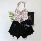 -Tan & Black Color -Bandana Print -Halter Top -Drawstring in Front -Ruffle Hem -Crop Top  Materials: 95% Polyester | 5% Spandex  BANDANA TANK TAN