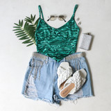 -Green and Black Marble Pattern -Tank Top -Spaghetti Straps -V-Neck -Bandana Cut at Hem -Crop Top -Breast Cups  Materials: 95% Polyester | 5% Spandex  MARBLE TOP GRN
