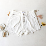 -White Denim -High Waisted -4 Buttons Up Front -Front & Back Pockets -Belt Loops -Distressed -Raw Hem -Shorts  Materials: 100% Cotton  CP5763 SHORT WHT