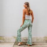 -Green and White Zebra Print -Zipper & Button Closure -Belt Loops -Flare Pant Leg -Pants  Materials: 70% Cotton | 30% Polyester  ZEBRA PANTS GRN